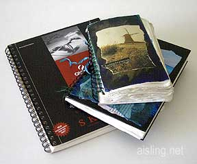 A stack of artists journals